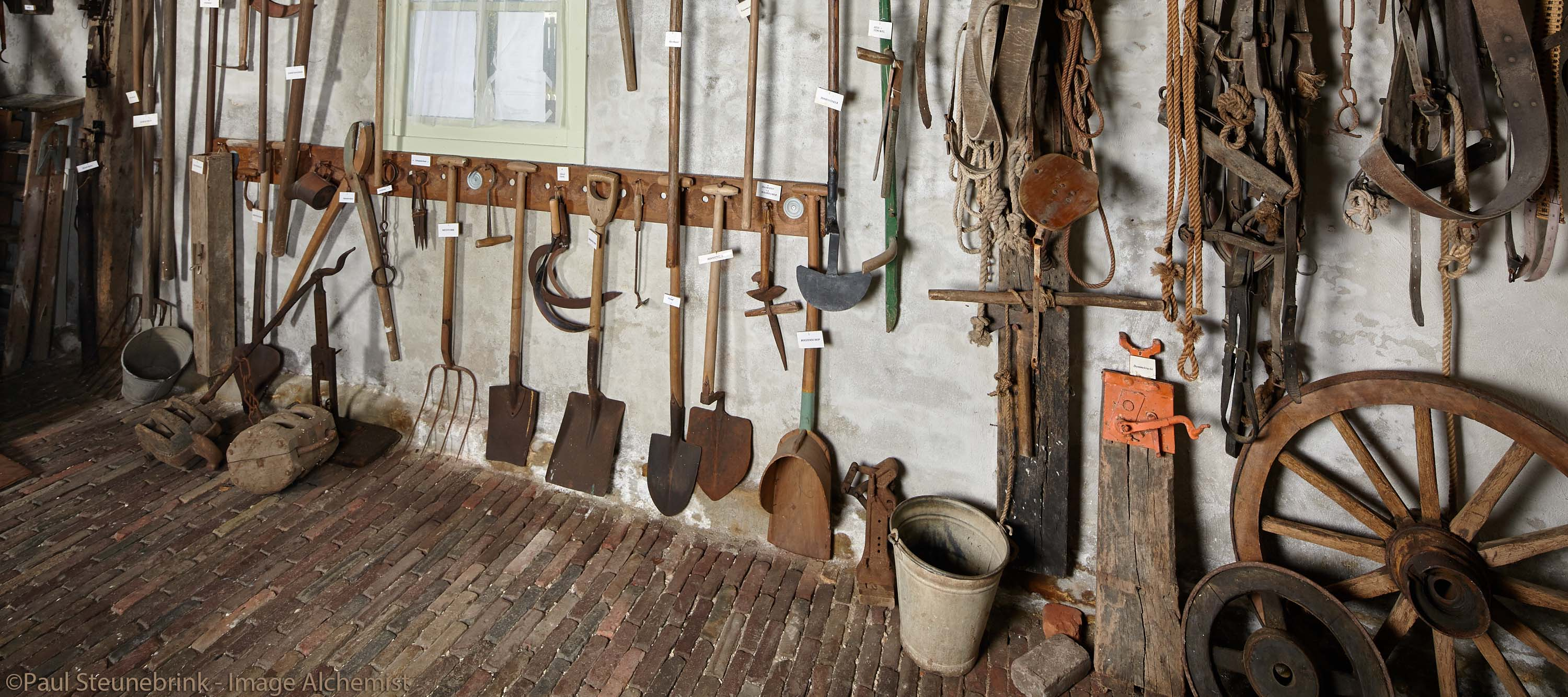 old tools with description in the museum farmhouse