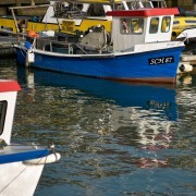 small blue boat, positive Clarity