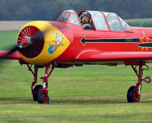 Yak-52 airplane just after landing on grass