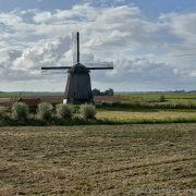 old windmill with grassland